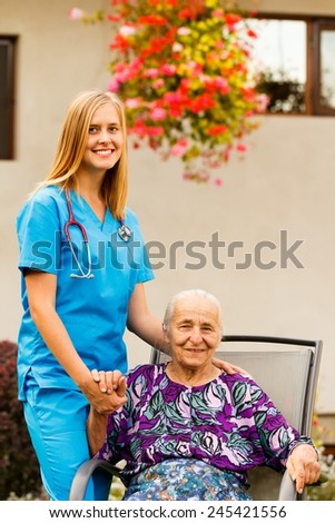 Elderly patient being supported by young female doctor. - stock photo
