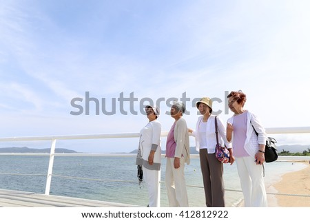 Elderly people are looking at the landscape - stock photo