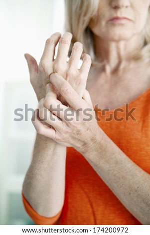 Elderly Person With Painful Hand - stock photo