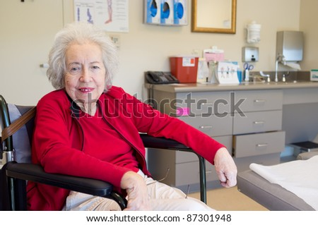 Elderly 80 plus year old woman with Alzheimer in a clinical setting. - stock photo