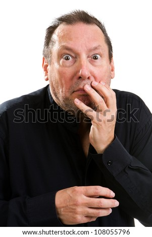 Elderly psychopathic man with a wild eyed look in his eyes holds his face with an shocked expression. - stock photo