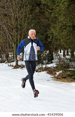 Elderly runners in winter on snow when jogging