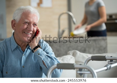 Elderly sick man talking the mobile phone - stock photo