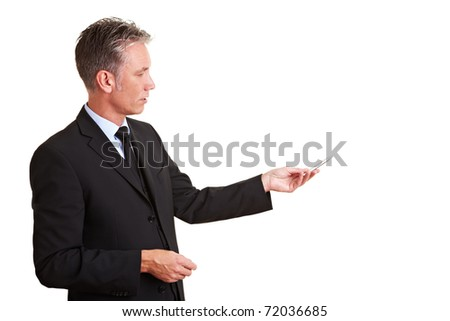 Elderly Teacher in a suit explaining something with a pen - stock photo
