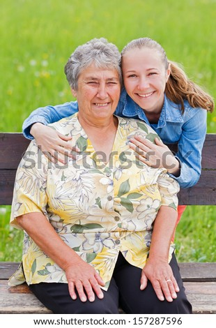 Elderly woman and her daughter enjoy themselves - stock photo