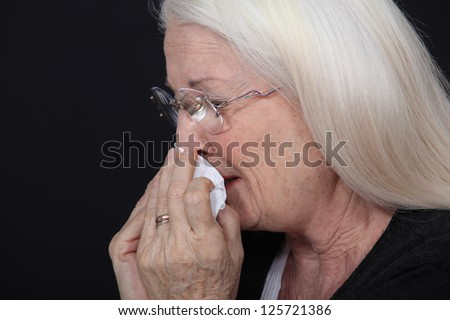 elderly woman crying - stock photo