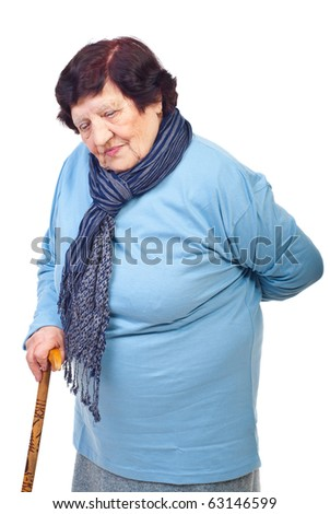 Elderly woman having back in pain, holding a cane  and looking down isolated on white background - stock photo
