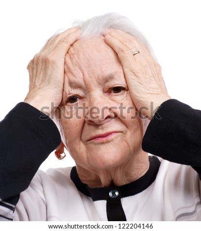 Elderly woman having headache on white background