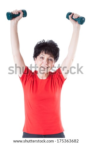 Elderly woman in red tshirt doing exercises with weights