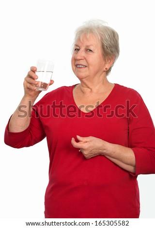 elderly woman is drinking water  - stock photo
