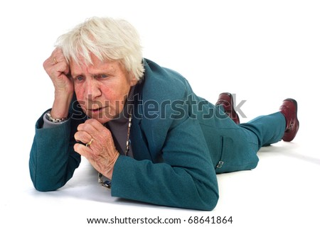 elderly woman is laying at the floor and thinking