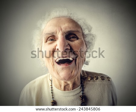 Elderly woman laughing  - stock photo