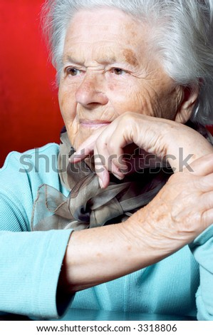 Elderly woman looking away and contemplating - stock photo