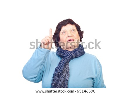 Elderly woman pointing up and copy space isolated on white background - stock photo