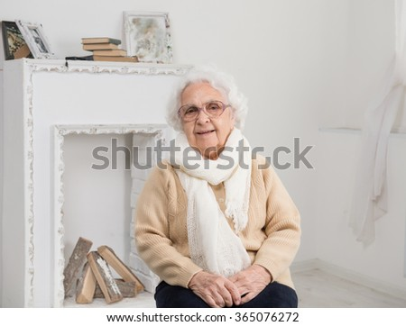 elderly woman portrait in interior - stock photo