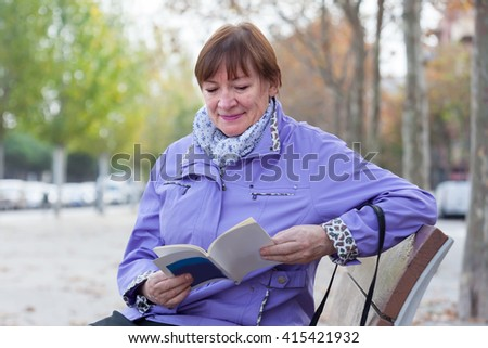 elderly woman  resting on   bench in   park.