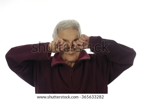 elderly woman rubbing eyes
