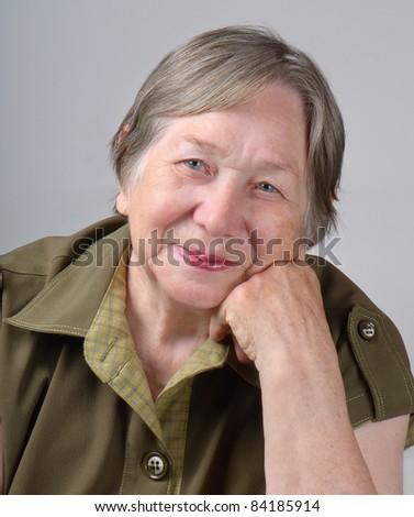 Elderly woman's portrait - stock photo