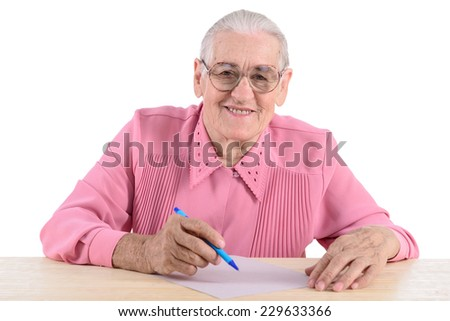 elderly woman smiles and writes the document. portrait isolated on white background - stock photo
