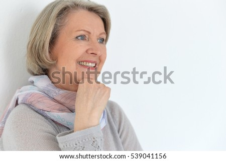elderly woman smiling and looking away
