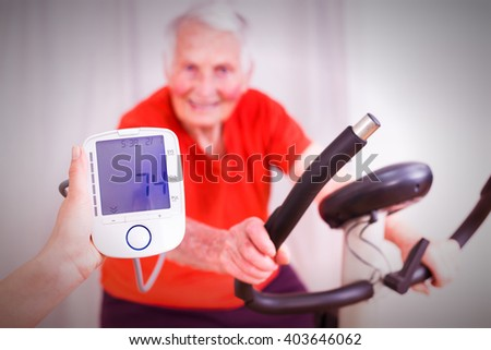 Elderly woman training, making effort, having hear heart condition, rate and blood pressure monitored by geriatric doctor.