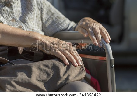 Elderly woman travel with wheelchair - stock photo