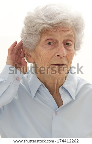 elderly woman trying to hear  - stock photo