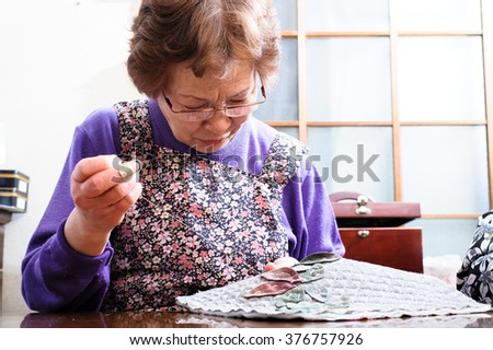 elderly woman with a sewing, Japanese - stock photo