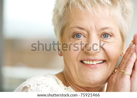 Elderly woman with cofee - stock photo