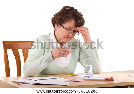 Elderly woman with headche worry about bill notice - stock photo