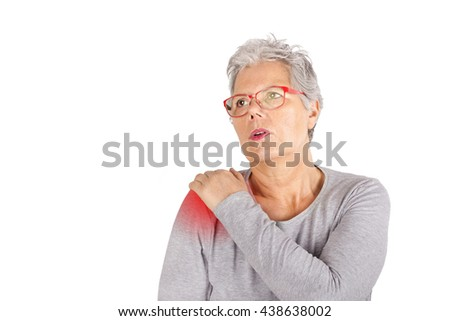 elderly woman with shoulder pain close up - stock photo