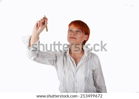 elderly woman writes a pen in the air