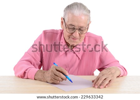 elderly woman writes the document. portrait isolated on white background