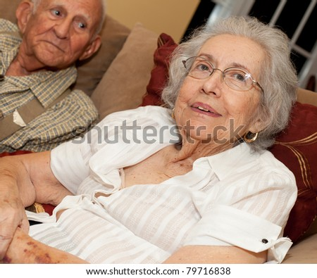 Elderly 80 year old woman with Alzheimer in a home setting. - stock photo