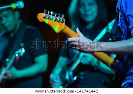 electic guitar in concert - stock photo