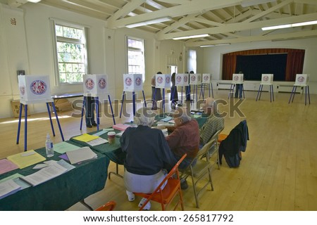 Election volunteers and voting booths in a polling place, CA - stock photo