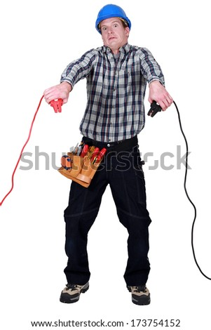 Electrian looking frightened - stock photo