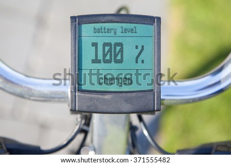 Electric bicycle display in the sun, 100 procent power left - stock photo