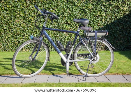 Electric bicycle in the sun, modern bike mostly used by seniors