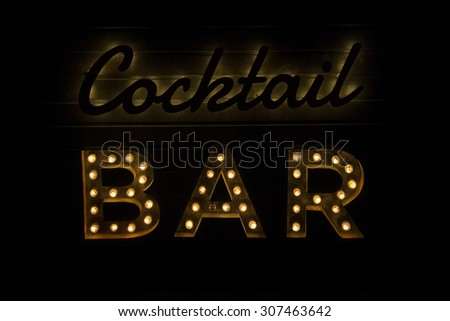 electric bulb sign of a Cocktail Bar - stock photo