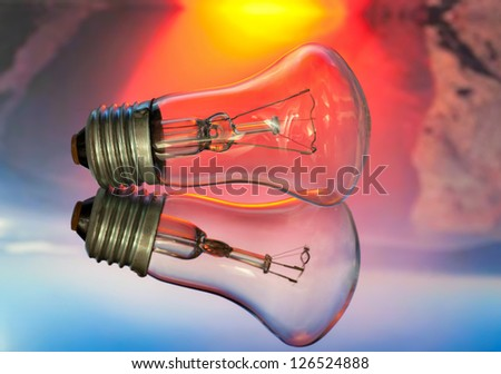 electric bulb with reflection in glass on a color background