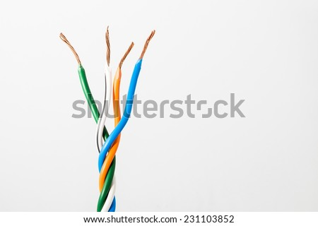 Electric cable ends, isolated on white. Colorful bundle of electric or electronic cables. - stock photo