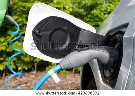 electric car being charged - stock photo