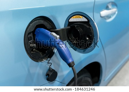 Electric Car Being Charged at the station closeup - stock photo