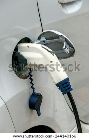 electric car charging station to. symbol of ecology, environmental protection, innovation - stock photo