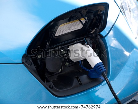 Electric car charging unit - stock photo