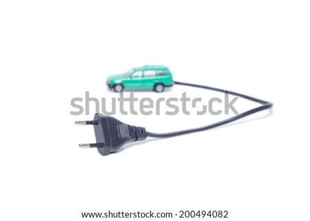 Electric car with plug to recharge battery - stock photo