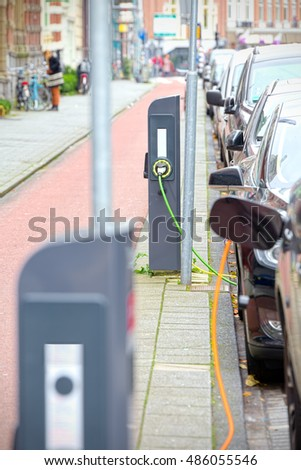 Electric cars charging on the road