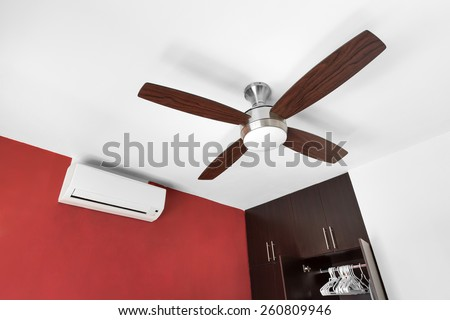 Electric ceiling fan and split-system air conditioner at the room