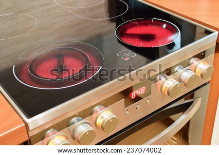 Electric ceramic stove inside the kitchen - stock photo